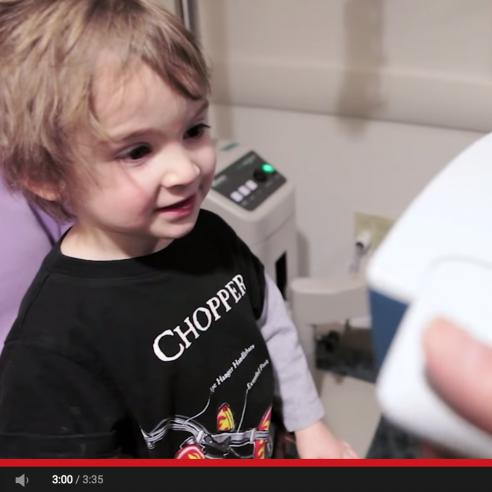Screenshot of video about a pediatric vision scanner