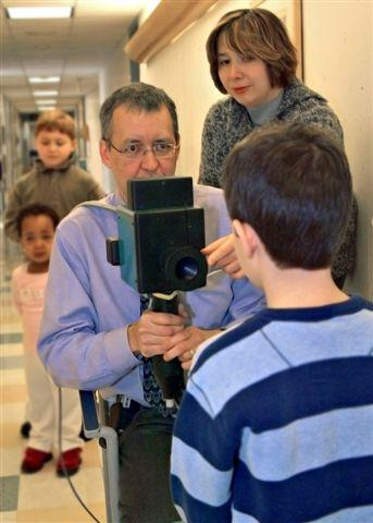 Dr. Hunter scans a child with a prototype vision screener